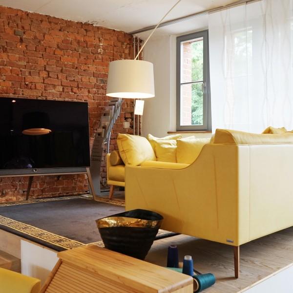 Designer Sofa von Artanova aus Leder und Naturmaterialien und Massivholz aus der Tuffner Möbelgalerie und Möbelhaus